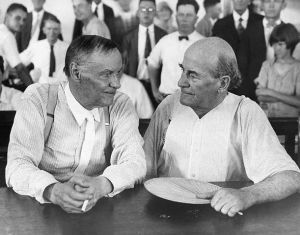 Clarence Darrow, a famous Chicago lawyer, and William Jennings Bryan, defender of Fundamentalism, have a friendly chat in a courtroom during the Scopes evolution trial. Darrow defended John T. Scopes, a biology teacher, who decided to test the new Tenessee law banning the teaching of evolution. Bryan took the stand for the prosecution as a bible expert. The trial in 1925 ended in conviction of Scopes. ca. 1925 Dayton, Tennessee, USA